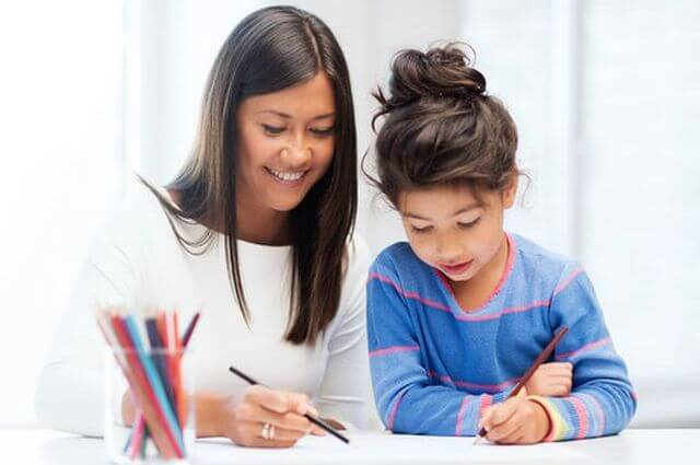 Tutor drawing with student - Home Tuition Hotspot Singapore