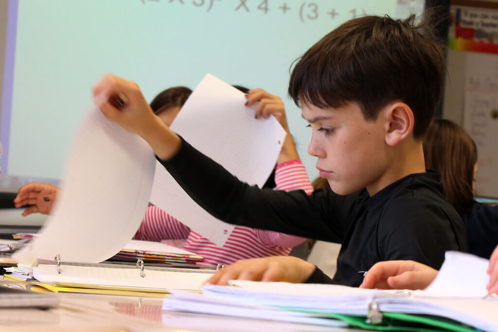 Child studying in the classroom - Home Tuition Hotspot Singapore