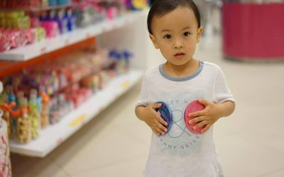 Child holding toys - Home Tuition Hotspot Singapore