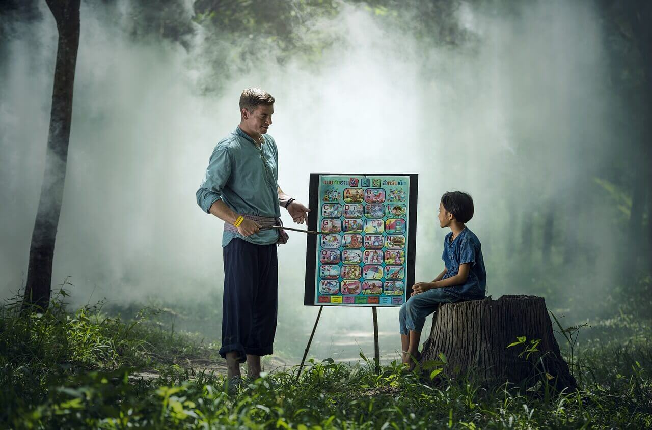 Teacher teaching a child in the forest - Home Tuition Hotspot Singapore